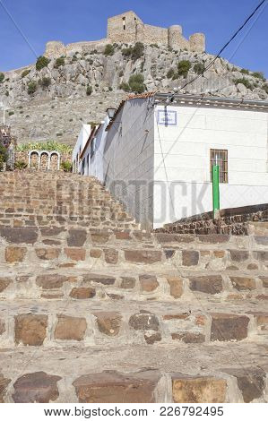 High Rocky Hill With Castle Of Belmez, Cordoba, Spain. View From Town Streets. Rafael Canalejo Stair