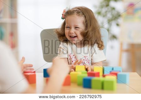 Mother And Kid Playing Colorful Block Toys At Home Or Daycare