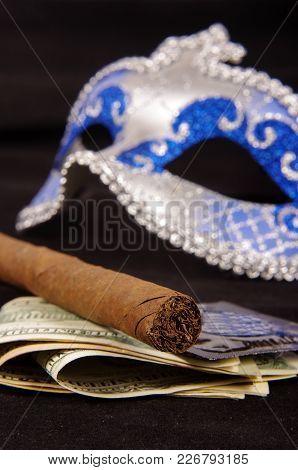 Prostitution Concept: Luxury Cigar, Money, Condoms And Seduction Domino Mask