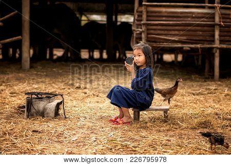 Asia Children Listen Radio In Countryside At Thailand.
