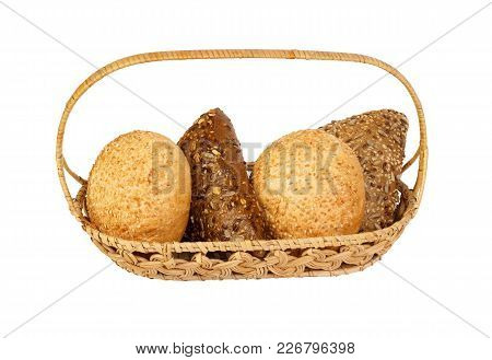 Various Types Of Bread In A Basket.
