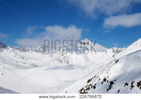 Off-piste Slope And Chair-lift On Ski Resort At Sun Day. Winter Caucasus Mountains In Haze, Georgia,