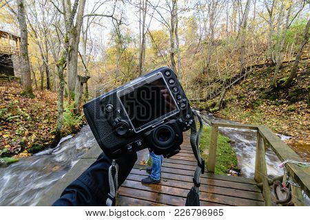 Male Photographer Enjoying Nature In Autumn