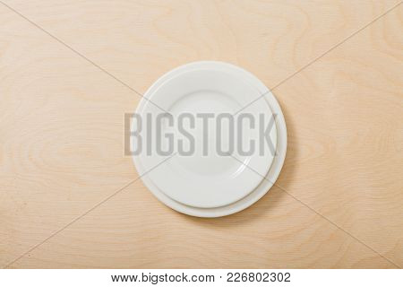 Plate. White. For The Dish. View From Above. Isolated.  For Your Design.