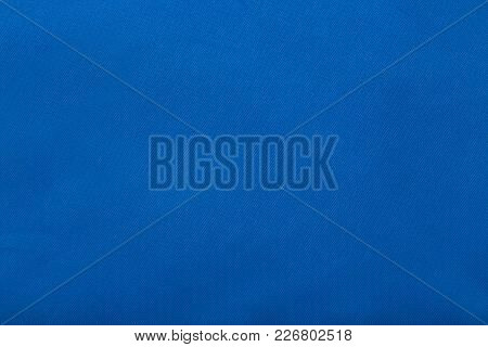 Blue Material Close. Texture. Background. Bright. For Your Design.