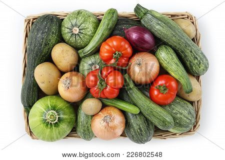 Top View Food Zucchini With Tomatoes, Onion And Potatoes In Wicker, Basket Isolated On White Backgro