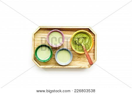 Make Matcha Tea. Matcha Tea In Small Cups Ready To Drink On White Background Top View.