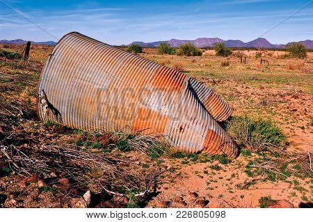 An Old Galvanized Steel Water Tank, Fallen Over And Slowly Rusting In The Arizona Desert Near Gila B