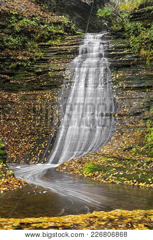 Colorful Autumn Leaves Surround Emerald Falls, A Beautiful Cascading Waterfall In Secluded Excelsior