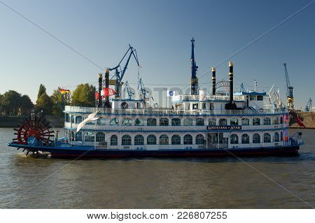 Hamburg, Germany - October 11, 2015: Touristic Paddle-steamer Louisiana Star On The Elbe River In Th