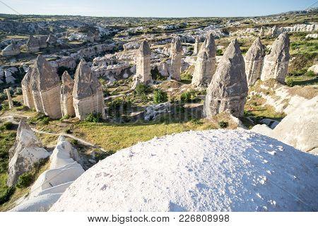 Love Valley In Goreme Village, Turkey. Rural Cappadocia Landscape. Stone Houses In Goreme, Cappadoci
