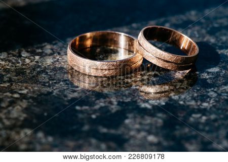 Wedding Rings For Newlyweds On A Dark Background