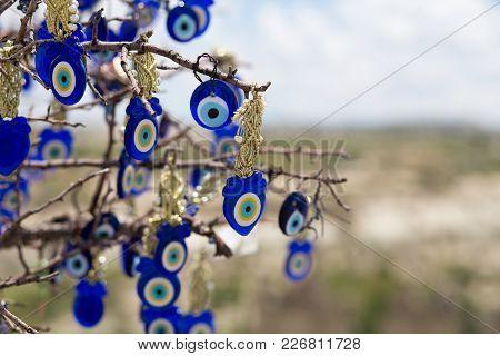 Famous Evil Eye Tree Scenery View In Cappadocia, Goreme, Turkey.