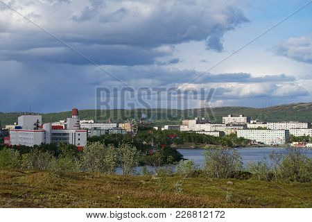 Murmansk, Russia-june 5, 2015: Urban Landscape With Modern Houses And Trees In The Open Air.