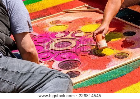 Antigua, Guatemala -  April 13, 2017: Decorating Dyed Sawdust Holy Thursday Procession Carpet In Tow