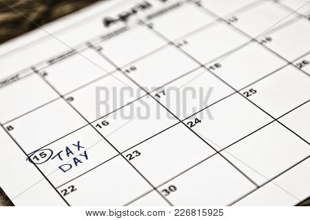 April 15th Is The Tax Day In The United States. As A Reminder, Calendar Sitting On Top Of 1040 Tax F