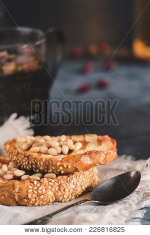 Toasts Of Bread With Sesame Seeds Homemade Cake In Stack Decorated With Pine Nut Linen Cotton Napkin