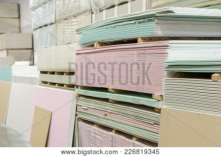 Warehouse With Plasterboard. Sheets Of Plasterboard On Pallets.