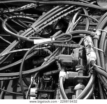 Protection Tubes, Pressure Wires And Corrugated Hoses Inside Engine Compartment Stock Photo