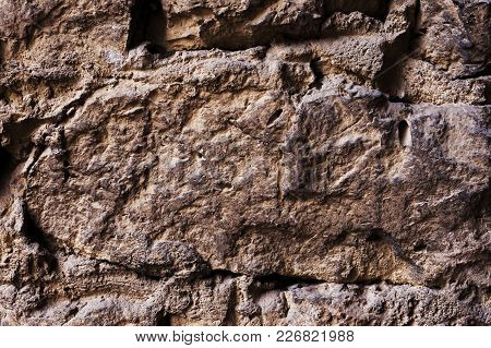 Close Up Large Stones In Medieval Masonry Textured Background Of A Wall Of Medieval Stone Masonry. T