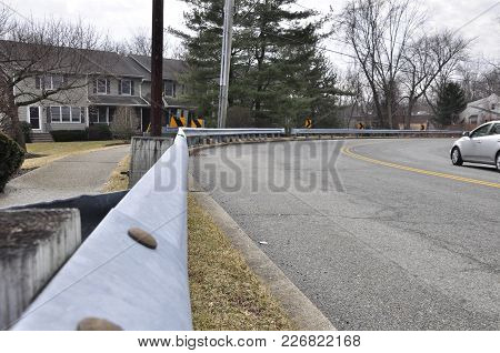 Guard Rail On Curving Road In Winter