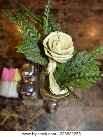 Vertical Sweet Grass Flower Centerpiece On Restaurant Table