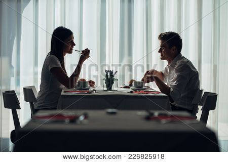 Two Casual Young Adults Having A Conversation Over A Meal.formal Proposal,talking In A Restaurant.tr