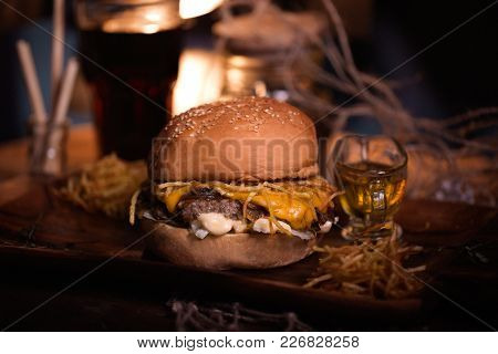 Burger Food Photo. Street Food. Fresh Tasty Grilled Beef Hamburger Cooked At Barbecue On Wooden Tabl