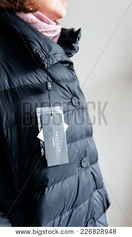 Paris, France - Feb 2, 2018: Side View Of Woman Wearing Max Mara Weekend Italian Buy New Fashionable