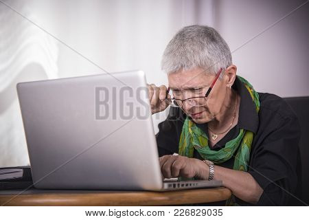 Senior Woman Having Troubles Reading Computer Text, Bad Eyesight