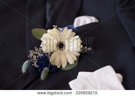 Corsage Boutonniere Brooch On A Man Groom Suit On Wedding Day.