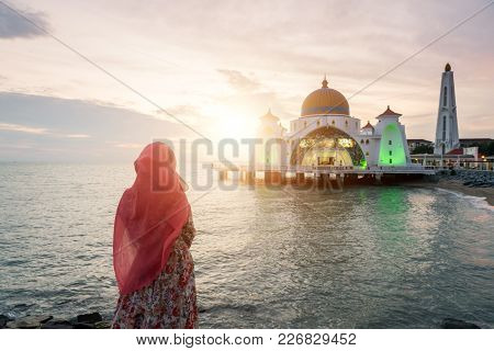 Malacca Straits Mosque With Muslim Pray In Malaysia. Malaysian Muslim With Mosque Religion Concept.