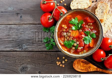 Homemade Tomato, Lentil Soup, Above View Corner Border With Copy Space On A Rustic Wood Background