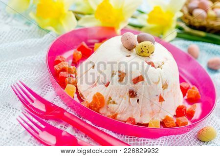 Traditional Easter Quark Dessert With Candied Fruit And Easter Candy Speckled Eggs