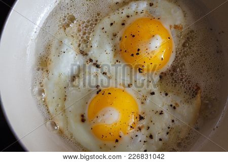 Fried Eggs From 2 Eggs In A Frying Pan. Hot Sunny Dish For A Nutritious Breakfast