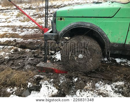 Wheel Car Lift Rack Jack. Wheel Green Machine Raised Out Of The Mud With The Help Of A Rack Jack. Th