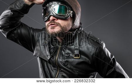 retro, old airplane pilot with brown leather jacket, arador hat and large glasses