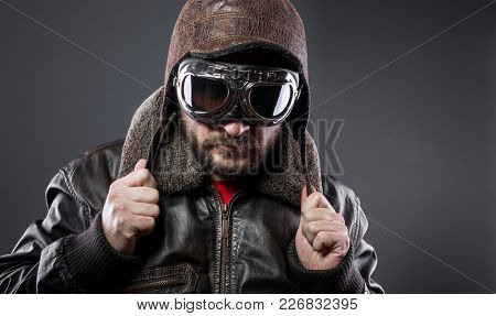Transportation, old airplane pilot with brown leather jacket, arador hat and large glasses