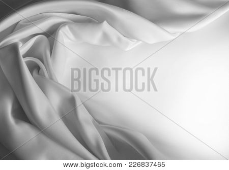Rippled white silk fabric. Copy space