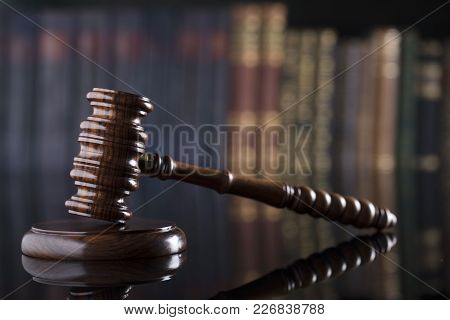 Law And Justice Theme. Gavel On Book Background And Glass Table.