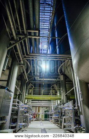 Modern Brewery. Large Vats For Beer  Fermentation And Maturation And Pipeline For Components Deliver