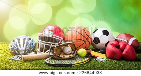Close-up Of Various Sport Equipments On Pitch Against Bokeh Background