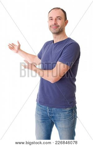 casual man with arm out in a showing gesture, isolated on white