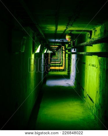 Psychedelic Green Deep In Underground Tunnel. Colored Industrial Background.