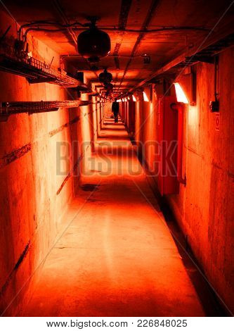 Psychedelic Red Deep In Underground Tunnel. Industrial Background With Creepy Stranger.