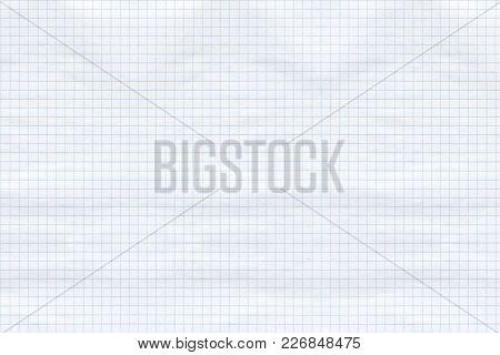 White Sheet Of Paper In A Little Blue Cell, A Sheet Of School Notebook, A Little Crumpled.