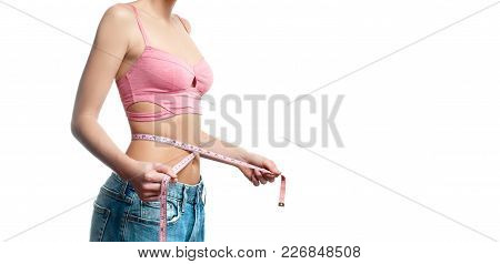 Diet Concept. Woman Is Measuring Waist After Weight Loss On White Background