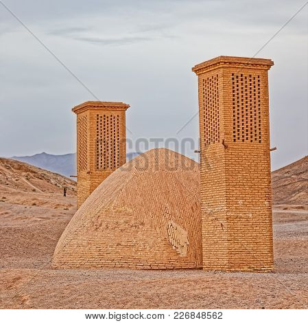 Yazd, Iran - May 4, 2015: View Of The Tourists Sightseeing The Tower Of Silence Disused Buildings At