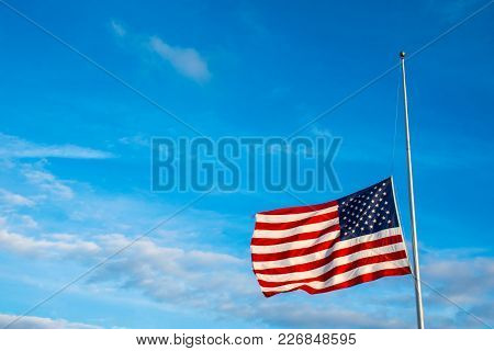 American Flag At Half Mast On A Perfect Flagpole After Another School Shooting With An Amazing Blue