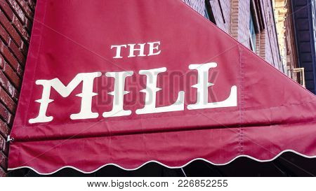 Nebraska, Usa - Aug 8, 2017: Red Awning With Logo Of The Mill Coffee And Tea Shop In The Haymarket D